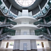 view of the central antrium featuring huge skylight architecture, building, daylighting, facade, metropolis, metropolitan area, structure, symmetry, black, gray