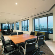 view of the informal office meeting area featuring ceiling, conference hall, interior design, office, penthouse apartment, property, real estate, window, orange
