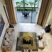 A view of the living area, cream carpet estate, floor, flooring, home, interior design, living room, room, table, window, gray, brown