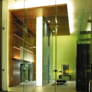 A view of the entrance way to the architecture, ceiling, door, glass, interior design, light fixture, lighting, lobby, wall, brown