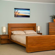 A view of some bedroom furniture from East bed, bed frame, bed sheet, bedroom, chest of drawers, drawer, floor, furniture, hardwood, interior design, mattress, nightstand, product, room, wood, gray, brown