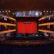 A view of the auditorium. - A view auditorium, concert hall, entertainment, lighting, night, performing arts center, stage, theatre, red, black