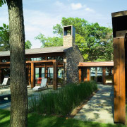 Image of the exterior of this beautiful lakeside architecture, cottage, grass, home, house, plant, real estate, tree, green
