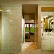 A view of the master bathroom, lights, brown bathroom, ceiling, door, estate, floor, flooring, home, interior design, lobby, real estate, room, wall, brown