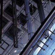 A close up view of the glass wall. angle, architecture, building, daylighting, daytime, facade, glass, line, metropolis, metropolitan area, reflection, sky, skyscraper, structure, symmetry, urban area, black