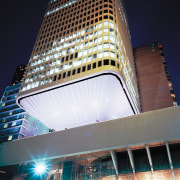 An exterior view of the building. - An architecture, building, city, cityscape, commercial building, condominium, corporate headquarters, daytime, downtown, facade, hotel, landmark, light, lighting, metropolis, metropolitan area, mixed use, night, reflection, sky, skyscraper, tower, tower block, urban area, black