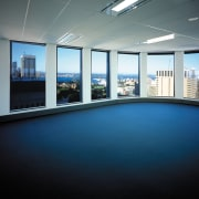 A view of some office space. - A architecture, daylighting, floor, flooring, interior design, lighting, property, real estate, window, black