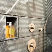 A view of a bathroom designed by David bathroom, floor, wall, wood, gray