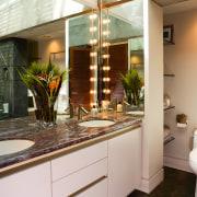 A view of a bathroom designed by David bathroom, countertop, home, interior design, room, brown, gray