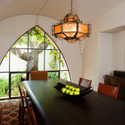 A Moorish, or Saracen, arch defines the formal ceiling, dining room, estate, home, interior design, living room, property, real estate, room, table, window, gray, black
