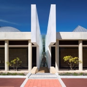 Exterior view of the freemantle Mausoleum featuring glass architecture, building, corporate headquarters, daytime, facade, home, house, real estate, sky, blue