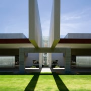 Exterior view of the freemantle Mausoleum featuring glass architecture, daytime, grass, house, landmark, sky, teal