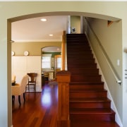 A view of the wooden staircase. - A architecture, ceiling, daylighting, floor, flooring, handrail, hardwood, home, house, interior design, laminate flooring, lighting, living room, real estate, stairs, wall, wood, wood flooring, gray, brown