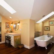 A view of the bathroom, wooden flooring, rugs, bathroom, ceiling, estate, floor, flooring, home, interior design, real estate, room, brown, gray, orange