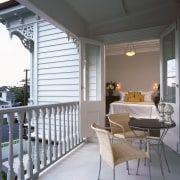 A view of the balcony area. - A architecture, balcony, furniture, home, house, interior design, outdoor structure, porch, window, gray, white