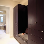 A view of the wooden cabinetry. - A cabinetry, furniture, interior design, room, wardrobe, black
