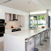 View of this kitchen featuring polished concrete flooring, countertop, interior design, kitchen, real estate, white, gray