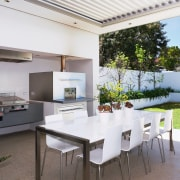 view of the outdoor kitchen featuring stainless steel architecture, daylighting, house, interior design, real estate, roof, table, white