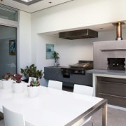 view of the outdoor kitchen featuring stainless steel countertop, interior design, kitchen, real estate, white, gray