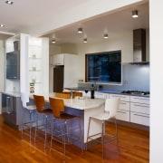 A view of the kitchen area, wooden flooring, floor, flooring, hardwood, interior design, kitchen, living room, property, real estate, room, wood flooring, white