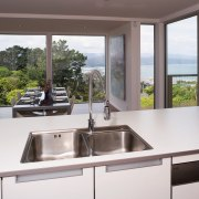 A vie wof a kitchen, cabinetry, glass benchtops, countertop, kitchen, property, real estate, window, white, gray