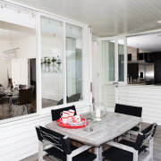 A view of the exterior dining area. - interior design, kitchen, living room, real estate, white, gray