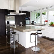 A view of the kitchen area, wooden flooring countertop, cuisine classique, floor, interior design, kitchen, real estate, white, black