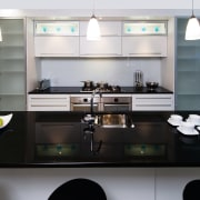 A view of a kitchen by Thermotek Kitchens. countertop, interior design, kitchen, product design, room, white, black
