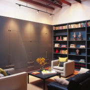 A view of the interior living area featuring ceiling, furniture, interior design, living room, loft, shelving, black