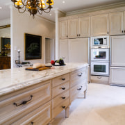 A view of the kitchen and dining areas, cabinetry, countertop, cuisine classique, floor, flooring, home, interior design, kitchen, room, wall, gray
