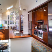 A view of this remodelled kitchen featuring cherry cabinetry, countertop, interior design, kitchen, real estate, room, gray