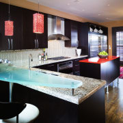A view of this kitchen featuring black cabinetry, countertop, interior design, kitchen, room, table, black