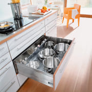 A view of some kitchen cabinetry by Blum countertop, floor, furniture, kitchen, kitchen appliance, kitchen stove, product design, table, white