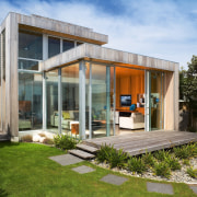 An exterior view of this house that features architecture, facade, home, house, property, real estate, brown