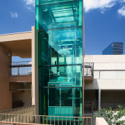 A view of some glasswork by G James architecture, building, commercial building, condominium, corporate headquarters, facade, house, mixed use, teal