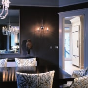 A view of the dining area featuring dark ceiling, dining room, home, interior design, lighting, living room, room, wall, window, black