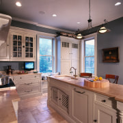 A view of this kitchen that features a cabinetry, ceiling, countertop, cuisine classique, flooring, home, interior design, kitchen, real estate, room, window, gray