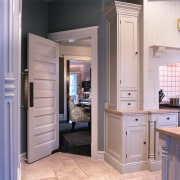 A view of this kitchen that features a bathroom accessory, bathroom cabinet, cabinetry, countertop, cuisine classique, floor, home, home appliance, interior design, kitchen, refrigerator, room, gray