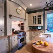 A view of this kitchen that features a cabinetry, countertop, cuisine classique, home, interior design, kitchen, real estate, room, gray