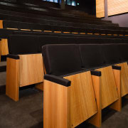 A view of some seating from Civic Seating architecture, auditorium, floor, flooring, furniture, interior design, lighting, product design, table, wood, black