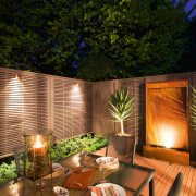 A view of this out door entertainment area backyard, home, house, interior design, landscape lighting, lighting, outdoor structure, property, real estate, brown