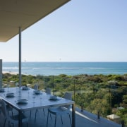 View of the Outdooe dining area on this apartment, condominium, house, property, real estate, resort, sea, sky, vacation, teal