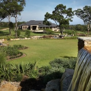 View of the landscaped gardens around the golf cottage, estate, grass, home, house, land lot, landscape, lawn, property, real estate, tree, yard, brown