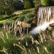 View of the landscaped gardens around the golf body of water, grass, grass family, landscape, nature, nature reserve, plant, tree, vegetation, water, water feature, water resources, watercourse, waterfall, brown