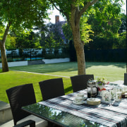 A view of the outdoor entertaining area featuring backyard, estate, garden, grass, house, lawn, outdoor structure, plant, property, real estate, table, tree, yard, green, black