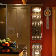 A view of a kitchen by Fyfe Kitchens. cabinetry, display case, furniture, interior design, room, brown