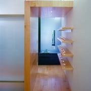 A close up view of the wooden shelving. architecture, ceiling, daylighting, floor, flooring, glass, hardwood, house, interior design, room, shelf, stairs, wall, wood, wood flooring, gray