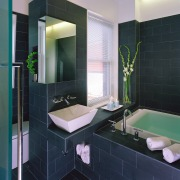 A view of the bathrrom, tiled floor and bathroom, floor, interior design, room, tile, black, gray