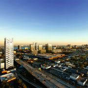 A view of this new innovative design of aerial photography, bird's eye view, building, city, cityscape, dawn, daytime, downtown, dusk, evening, horizon, metropolis, metropolitan area, mixed use, morning, real estate, residential area, sky, skyline, skyscraper, suburb, sunset, tower, tower block, urban area, black