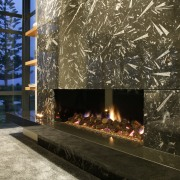A view of a fireplace from Living Flame. hearth, home, tree, black